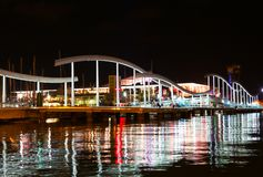 Barcelona Port Vell night view. Barcelona colored Port Vell night view from local beach royalty free stock photography