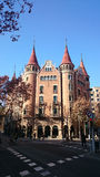 Barcelona crossroad and turret building. Building with turrets in Barcelona, Catalonia, Spain Royalty Free Stock Images