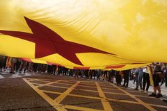 Barcelona demo for independence detail under giant flag. Students carry a giant catalan pro separatist flag called estelada  during a massive demonstration pro Stock Photo