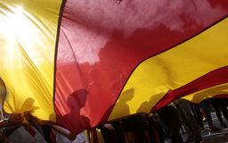 Barcelona demo for independence detail under giant flag. Students carry a giant catalan pro separatist flag called estelada  during a massive demonstration pro Royalty Free Stock Images