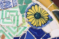 Barcelona detail. Floral mosaic in Antoni Gaudi's Park Guell - Barcelona detail. Artistic background texture of trencadis Stock Photo