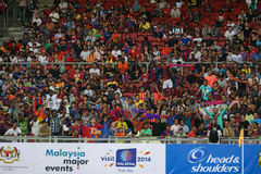 Barcelona fans. KUALA LUMPUR - AUGUST 09: Barcelona Football Club fans fill up the stadium seats during a training session at the Bukit Jalil National Stadium on Royalty Free Stock Images