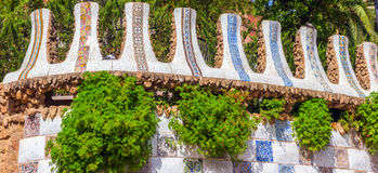 Barcelona Fence Gaudi. Mosaic Fence at the Parc Guell designed by Antoni Gaudi located on Carmel Hill, Barcelona, Spain stock image