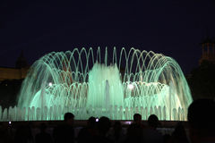 Barcelona fountain. Lighted green water fountain at night in Barcelona, Spain Stock Photo