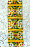 Barcelona Gaudi. Mosaic at the exterior Parc Guell designed by Antoni Gaudi located on Carmel Hill, Barcelona, Spain Royalty Free Stock Image