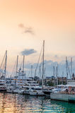 Barcelona harbor yacht and boats. At sunset stock images