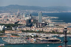 Barcelona Harbour Catalunia Spain. The harbour of Barcelona, the modern buildings and boats Catalunia, Spain stock photography