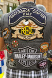 BARCELONA HARLEY DAYS 2012. BARCELONA, SPAIN - JULY 08: Unidentified persons with typical biker jacket a Harley Davidson motorbike at an exhibition during Royalty Free Stock Photos