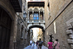 BARCELONA-JULY 22: Carrer del Bisbe Irurita in the Gothic Quarter on July 22, 2012 in Barcelona. Catalonia. Spain. Royalty Free Stock Photography