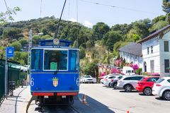 Nostalgic Blue Tram to Tibidabo. Inaugurated in 1901, still uses the same streetcars, thus being one of. BARCELONA - July 13, 2016: Nostalgic Blue Tram to Stock Photography