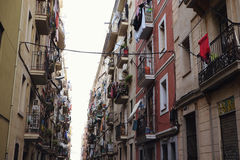 BARCELONA - JULY 29, 2016: View down a densely populated narrow residential street Royalty Free Stock Image