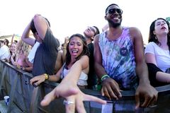 Crowd dance in a concert at Sonar Festival. BARCELONA - JUN 19: Crowd dance in a concert at Sonar Festival on June 19, 2015 in Barcelona, Spain Royalty Free Stock Photography