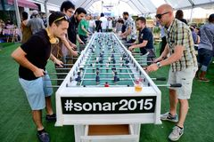 People play in a extra large foosball also know as table soccer and table football  at Sonar Festival Royalty Free Stock Photo
