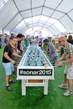 People play in a extra large foosball also know as table soccer and table football  at Sonar Festival Stock Photography