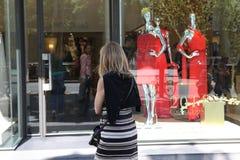 BARCELONA - JUNE 10 : Customer woman in shopping street, looking Stock Photo