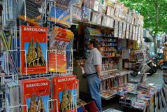 Barcelona kiosk with maps magazines newspapers. Tourists and locals alike are universally drawn to kiosk with maps and newspapers all across Europe royalty free stock photography