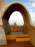 Barcelona, La Pedrera 11. The famous La Pedrera in Barcelona, Spain with Segrada Familia in the background Stock Photos