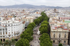 Barcelona - La Ramblas (Spain). A aerial view of the famous La Rambla street in the heart of Barcelona city in Spain. Showing the line of trees which outline the Stock Images