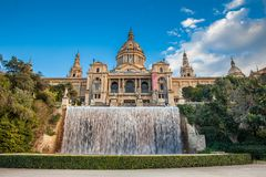Magic Fountain of Montjuic and the Museu Nacional de art de Catalunya. BARCELONA - MARCH, 2018: Magic Fountain of Montjuic and the Museu Nacional de art de royalty free stock image