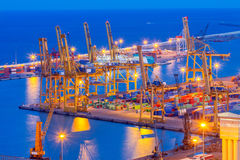 Barcelona. Marine cargo port at night. View cargo port and large cranes in Barcelona from Montjuic hill Stock Images