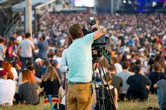 A video producer in a concert at Primavera Sound 2017 Festival. BARCELONA - MAY 31: A video producer in a concert at Primavera Sound 2017 Festival on May 31 royalty free stock image