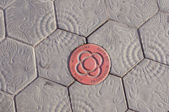 Barcelona Modernism Route. Red guide mark of Barcelona Modernism Route between street pavement tiles. This is Barcelona Municipal project for discovering and stock photography