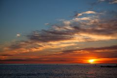 Barcelona morning sunrise on sea. View from beach royalty free stock photo