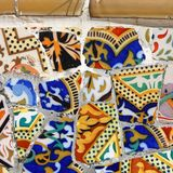 Barcelona mosaic. Mosaic in Antoni Gaudi's Park Guell - Barcelona detail. Artistic background texture of trencadis. Square composition Royalty Free Stock Photos