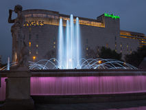 Barcelona night view fountains and shopping center. The catalan capital of Barcelona aat the famous Plaça de Catalunya square with nocturnal illumination of it Stock Photos