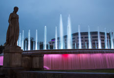 Barcelona night view fountains and shopping center. The catalan capital of Barcelona aat the famous Plaça de Catalunya square with nocturnal illumination of it Royalty Free Stock Photo