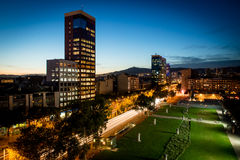 Barcelona night view. Night view of barcelona iluminated by city lights with cars' lights tracks Royalty Free Stock Images