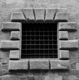 Barcelona old gothic window. With metal grill stock photos