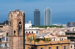 Barcelona - old and new. View of Barcelona with belltower of Capella de Santa Agata and skyscrapers.  royalty free stock images