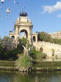 Barcelona park. Park in bercelona with flying pigeons Stock Photo