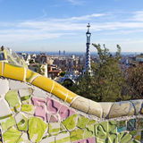 Barcelona from Park Guell. Artistic background of broken tiles. Trenkadis is an artistic technique invented by the modernist Catalan architect, Antonio Gaudi Royalty Free Stock Photos