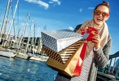 Woman on embankment in Barcelona, Spain showing Christmas gift Stock Photography