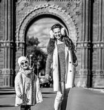 Mother and child standing near Arc de Triomf in Barcelona. In Barcelona for a perfect winter. Full length portrait of happy trendy mother and child standing near Royalty Free Stock Images