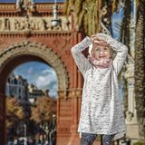 Smiling trendy child in Barcelona, Spain standing. In Barcelona for a perfect winter. Full length portrait of smiling trendy child in Barcelona, Spain standing Royalty Free Stock Photos