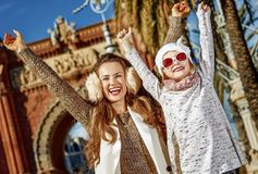 Mother and child near Arc de Triomf in Barcelona rejoicing. In Barcelona for a perfect winter. happy trendy mother and child near Arc de Triomf in Barcelona Stock Photography