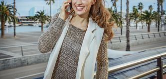Happy tourist woman in Barcelona, Spain speaking on cell phone Stock Photos