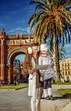 Mother and child near Arc de Triomf in Barcelona looking at map. In Barcelona for a perfect winter. happy young mother and child near Arc de Triomf in Barcelona Stock Images