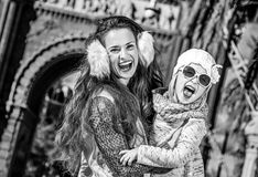 Mother and daughter near Arc de Triomf in Barcelona, Spain. In Barcelona for a perfect winter. Portrait of cheerful modern mother and daughter near Arc de Triomf Stock Photo