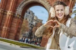 Fashion-monger near Arc de Triomf showing heart shaped hands Royalty Free Stock Image