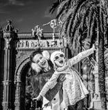 Mother and daughter near Arc de Triomf having fun time. In Barcelona for a perfect winter. Portrait of smiling trendy mother and daughter near Arc de Triomf in Stock Image