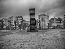 Barcelona: Pic of the Barceloneta neighborhood from the beach. A day of rain royalty free stock photos