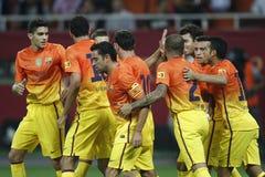 Barcelona players celebrating a goal. Players of FC Barcelona celebrating the goal of Leo Messi during the friendly match with Dinamo Bucharest. FC Barcelona won Stock Photos