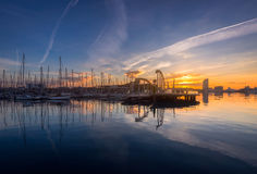 Barcelona Port Vell with Sailboat. And yachts at sunrise in Barcelona, Spain Royalty Free Stock Photo