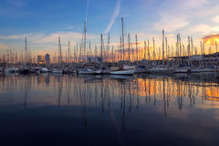Barcelona Port Vell with Sailboat. And yachts at sunrise in Barcelona, Spain Stock Photo
