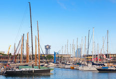 Barcelona port view with Montjuic cable car tower and yachts Royalty Free Stock Image