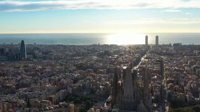 Barcelona Sagrada familia church. Aerial video footage. Sunrise backlight stock footage